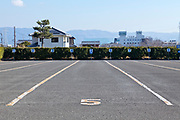 large bus parking lot at the Yakushiji Temple complex in Nara Japan