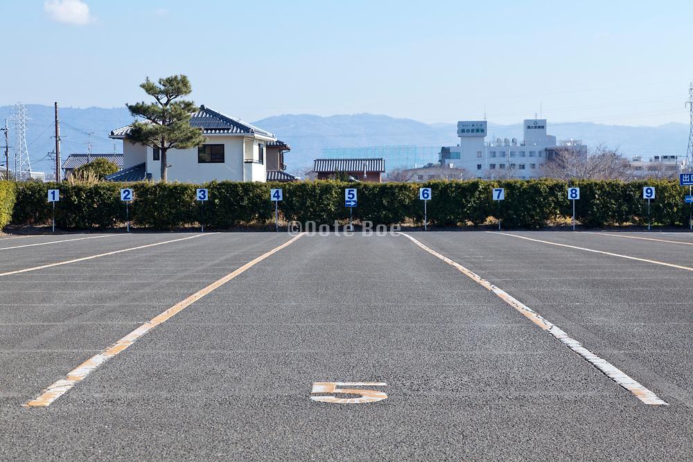 large bus parking lot at the Yakushiji Temple complex in Nara Japan