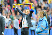 AFC Wimbledon manager Neal Ardley celebrates promotion in front of the AFC Wimbledon fans after the Sky Bet League 2 play off final match between AFC Wimbledon and Plymouth Argyle at Wembley Stadium, London, England on 30 May 2016. Photo by Graham Hunt.