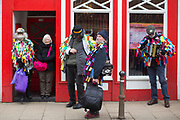 UNITED KINGDOM, Whittlesey: Straw Bear Festival. Locals on the streets of Whittlesey during the Straw Bear festival this weekend. The colourful three day festival, which originated in 1882, consists of traditional Molly, Morris, Clog and Sword dancing as well as parading a large straw character known as 'The Bear' through the town. Rick Findler  / Story Picture Agency