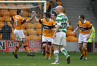 Photo: Paul Thomas.<br /> Motherwell v Glasgow Celtic. Bank of Scotland Scottish Premier League. 30/12/2006.<br /> <br /> Darren Smith (2nd from L) and Motherwell celebrate his goal which made it 1 -1, right on full -time, while Celtic's Thomas Gravesen looks away.