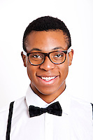 Portrait of young man wearing glasses over white background
