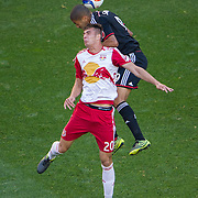 Nov 8, 2015; Harrison, NJ, USA; D.C. United forward Alvaro Saboru (9) heads the ball being defended by New York Red Bulls defender Matt Miazga (20) during the first half of the MLS Playoffs at Red Bull Arena. Mandatory Credit: William Hauser-USA TODAY Sports