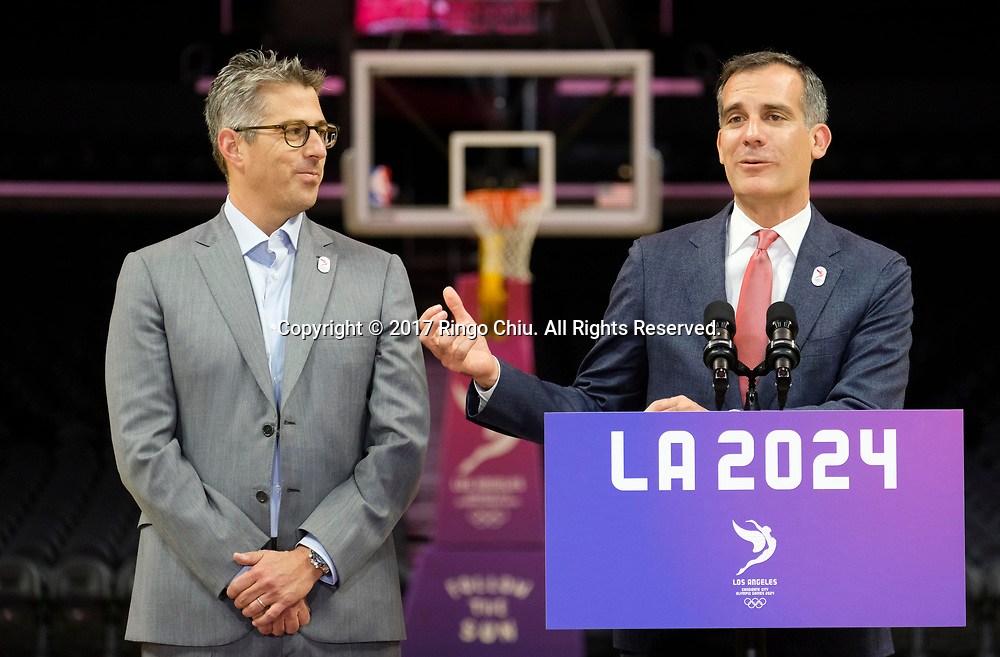 Los Angeles 2024 Chairman Casey Wasserman, left, looks on as Los Angeles Mayor Eric Garcetti speaks during a news conference at Staples Center, Friday, May 12, 2017, in Los Angeles. A team of International Olympic Committee delegates wrap up four days of evaluating Los Angeles' bid for the 2024 Games before heading to Paris to check the only other candidate.(Photo by Ringo Chiu/PHOTOFORMULA.com)<br /> <br /> Usage Notes: This content is intended for editorial use only. For other uses, additional clearances may be required.