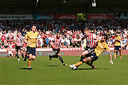 Nottingham Forest defender Danny Fox (4) makes a strong tackle on Brentford midfielder Lewis Macleod (4) during the EFL Sky Bet Championship match between Brentford and Nottingham Forest at Griffin Park, London, England on 1 September 2018.