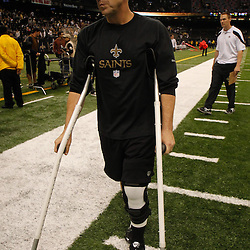 December 4, 2011; New Orleans, LA, USA; New Orleans Saints head coach Sean Payton leaves the field on crutches following a win over the Detroit Lions at the Mercedes-Benz Superdome. The Saints defeated the Lions 31-17. Mandatory Credit: Derick E. Hingle-US PRESSWIRE