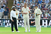 Stuart Broad of England and Joe Root of England talk with umpire Aleen Dar about the light during the International Test Match 2019 match between England and Australia at Edgbaston, Birmingham, United Kingdom on 3 August 2019.