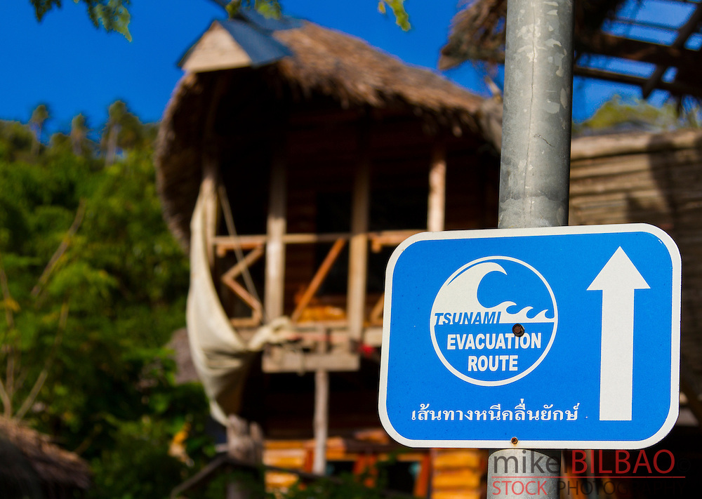Tsunami evacuation route sign. Ton Sai village. Phi Phi Don island. Krabi province, Andaman Sea, Thailand.