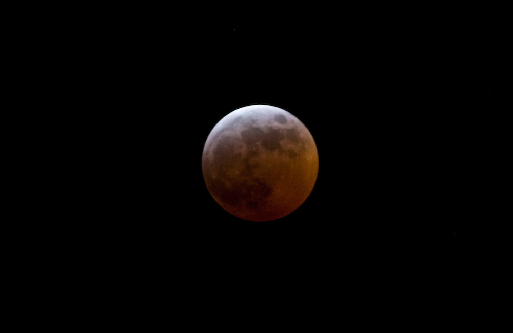 Red moon caused by refracted sunlight during lunar eclipse, Southern England, United Kingdom