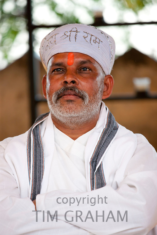 Hindu priest at Holi festival of 76th Maharana of Mewar, Shriji Arvind Singh Mewar of Udaipur, at the City Palace, Rajasthan, India
