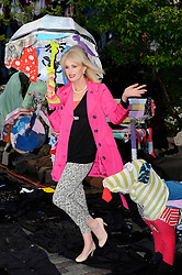 "Joanna Lumley at the launch of ""Shwopping"". Using 5 minutes worth of UK clothing waste M&S transformed a London street to show how it plans to give old clothes a future through it's new fashion initiative, Wednesday, 25th April 2012.  Photo by: Chris Joseph / i-Images"