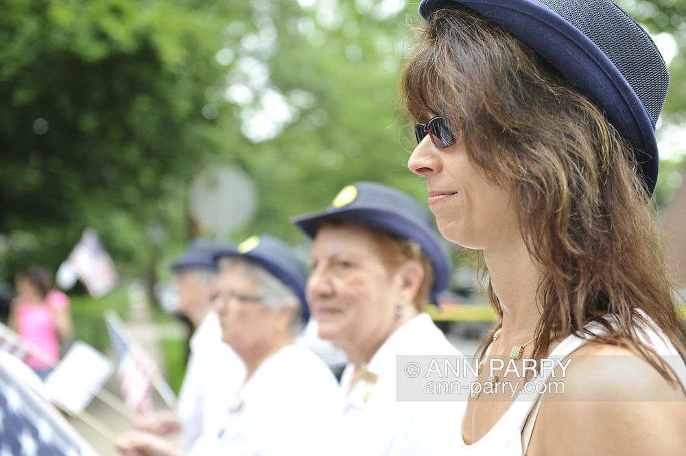 American Legion Merrick Post 1282 Auxiliary member Margaret Biegelman (right) marching with fellow members in the Merrick Memorial Day Parade on Monday, May 28, 2012, on Long Island, New York, USA. America's war heroes are honored on this National Holiday.