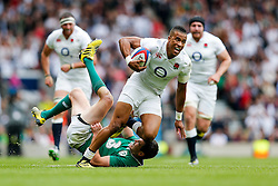 England Winger Anthony Watson is challenged by Ireland Fly-Half Johnny Sexton - Mandatory byline: Rogan Thomson/JMP - 07966 386802 - 05/09/2015 - RUGBY UNION - Twickenham Stadium - London, England - England v Ireland - QBE Internationals 2015.
