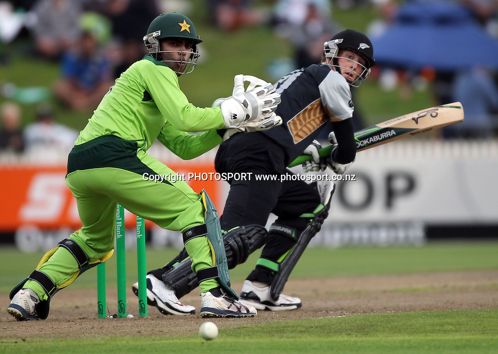 New Zealand batsman Martin Guptill in action batting as Umar Akmal looks on. New Zealand Black Caps v Pakistan, Match 2. Twenty 20 Cricket match at Seddon Park, Hamilton, New Zealand. Tuesday 28 December 2010. Photo: Andrew Cornaga/photosport.co.nz