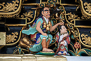 "Carvings on Yomeimon Gate, one of Japan's most intricately decorated structures. Toshogu Shrine is the final resting place of Tokugawa Ieyasu, the founder of the Tokugawa Shogunate that ruled Japan for over 250 years until 1868. Ieyasu is enshrined at Toshogu as the deity Tosho Daigongen, ""Great Deity of the East Shining Light"". Initially a relatively simple mausoleum, Toshogu was enlarged into the spectacular complex seen today by Ieyasu's grandson Iemitsu during the first half of the 1600s. The lavishly decorated shrine complex consists of more than a dozen buildings set in a beautiful forest. Countless wood carvings and large amounts of gold leaf were used to decorate the buildings in a way not seen elsewhere in Japan. Toshogu contains both Shinto and Buddhist elements, as was common until the Meiji Period when Shinto was deliberately separated from Buddhism. Toshogu is part of Shrines and Temples of Nikko UNESCO World Heritage site."