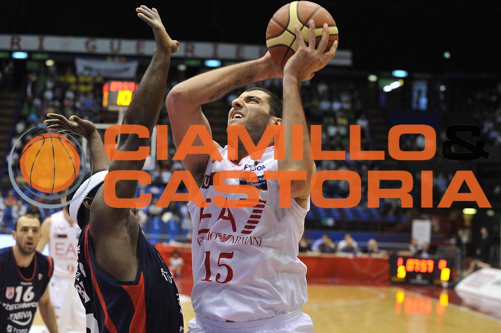 DESCRIZIONE : Milano Lega A 2011-12 EA7 Emporio Armani Milano Bancatercas Teramo <br /> GIOCATORE : ioannis bourousis<br /> CATEGORIA :  tiro<br /> SQUADRA : EA7 Emporio Armani Milano Bancatercas Teramo <br /> EVENTO : Campionato Lega A 2011-2012<br /> GARA : EA7 Emporio Armani Milano Bancatercas Teramo<br /> DATA : 29/04/2012<br /> SPORT : Pallacanestro<br /> AUTORE : Agenzia Ciamillo-Castoria/M.Gregolin<br /> Galleria : Lega Basket A 2011-2012<br /> Fotonotizia :  Milano Lega A 2011-12 EA7 Emporio Armani Milano Bancatercas Teramo <br /> Predefinita :