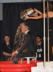 JAMES NESBITT takes the ALS Ice Bucket Challenge at the GQ Men Of The Year 2014 Awards in association with Hugo Boss held at The Royal Opera House, London on 2nd September 2014.