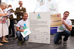 "© Licensed to London News Pictures. 07/08/2014. London, UK. TV historian and presenter, Dan Snow and supporters unveil a giant copy of a letter to Scotland signed by famous figures calling on Scotland to remain part of Great Britain at More London riverside in London on 7th August 2014. The letter is part of the ""Let's Stay Together"" campaign which is against Scottish independence.  Photo credit : Vickie Flores/LNP"