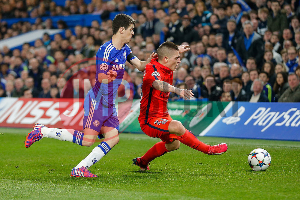 Marco Verratti of Paris Saint-Germain is challenged by Oscar of Chelsea - Photo mandatory by-line: Rogan Thomson/JMP - 07966 386802 - 11/03/2015 - SPORT - FOOTBALL - London, England - Stamford Bridge - Chelsea v Paris Saint-Germain - UEFA Champions League Round of 16 Second Leg.