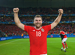 LILLE, FRANCE - Friday, July 1, 2016: Wales' goal-scorer Sam Vokes celebrates after a 3-1 victory over Belgium and reaching the Semi-Final during the UEFA Euro 2016 Championship Quarter-Final match at the Stade Pierre Mauroy. (Pic by David Rawcliffe/Propaganda)