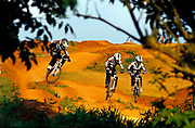 Mountain bikers, Scott Edgworth, Toby, Forte, Ian Gunner, riding the man made humps in unicen