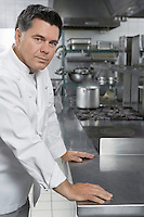 Male chef in kitchen portrait