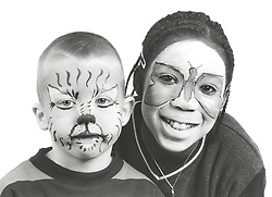 Two children with their faces painted,