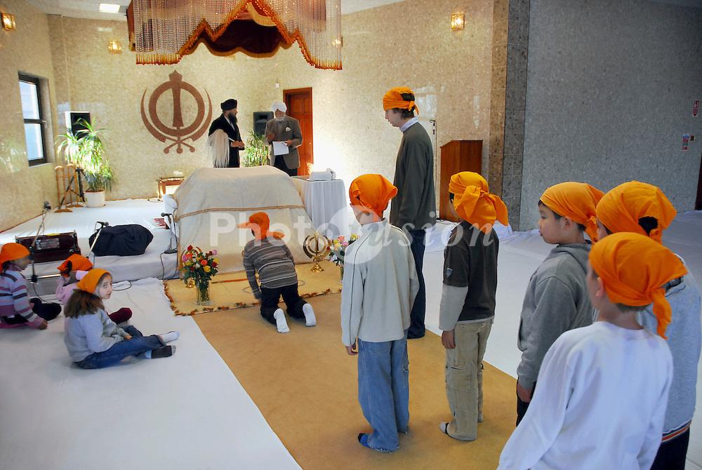 Primary schoolchildren on school visit to Sikh gurdwara; London  UK