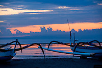 Balinese fishing boats at dawn on a beach in Bali, Indonesia