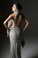 Rear view of woman in backless dress