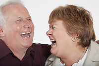 Middle-aged couple laughing close-up
