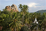 Sri Lanka. Mihintale, 12km east of Anuradhapura, is famous as the place where Buddhism was introduced to Sri Lanka. The bare rock outcrop of Aradhana Gala in the  background.