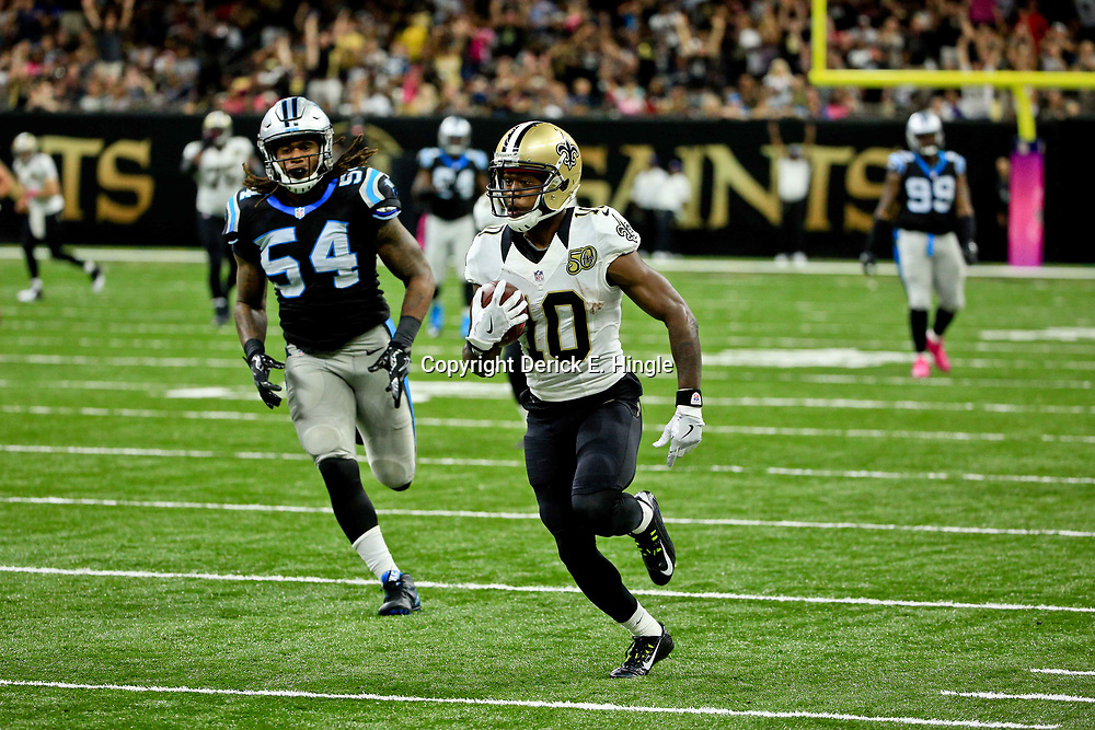 Oct 16, 2016; New Orleans, LA, USA; New Orleans Saints wide receiver Brandin Cooks (10) catches a touchdown over Carolina Panthers outside linebacker Shaq Green-Thompson (54) during the fourth quarter of a game at the Mercedes-Benz Superdome. The Saints defeated the Panthers 41-38. Mandatory Credit: Derick E. Hingle-USA TODAY Sports