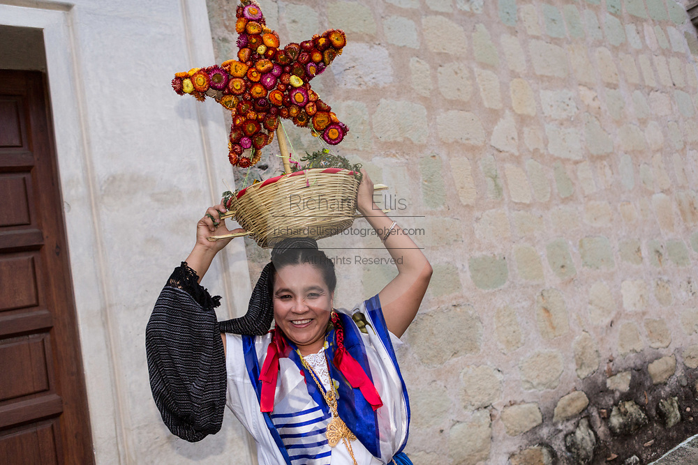 A women dressed in traditional costumes parade in a comparsas past the Santo Domingo de Guzmán Church during the Day of the Dead Festival known in Spanish as Día de Muertos in Oaxaca, Mexico.