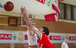 Vlado Pasalic of Helios vs Milan Sebic  of Sentjur  during basketball match between KK Helios Domzale and KK Sentjur in 1st Quarterfinal of Spar Slovenian Cup, on February 10, 2011 in Sportna dvorana Poden, Skofja Loka, Slovenia. Helios defeated Sentjur 83-62. (Photo By Vid Ponikvar / Sportida.com)