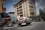 Family moving into the new house in the Kars center.<br /> <br /> Kars is a main city of the region but still maintains very agriculture feel to it. On the bazaar one could see tractors and agriculture machinery as a main product for sale.