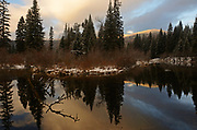 Upper Ford pond at sunrise in late fall. Yaak Valley in the Purcell Mountains, northwest Montana.