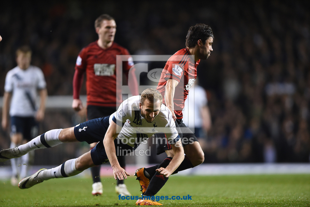 Tottenham Hotspur's Harry Kane is fouled by West Bromwich Albion's Claudio Yacob during the Barclays Premier League match at White Hart Lane, London<br /> Picture by Daniel Hambury/Focus Images Ltd +44 7813 022858<br /> 25/04/2016