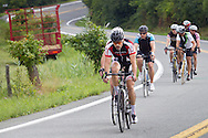 Goshen, New York - Riders head down Maple Avenue during the Tour de Goshen charity bicycle ride on Aug. 16, 2014.