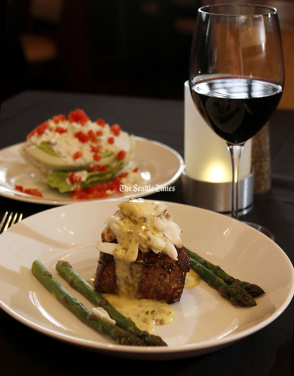 Sullivan's Steakhouse features The Filet Oscar, with Iceberg Lettuce Wedge and a red wine.<br /> Jim Bates / The Seattle Times