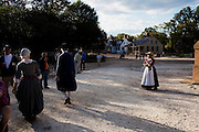 Williamsburg, VA - October 5, 2010: Actor-interpretor Deidre Jones (in hat, far right) stands off by herself after a performance in Colonial Williamsburg, Virginia on Tuesday, October 5, 2010.<br /> <br /> (Photo by Matt Eich/LUCEO for The Washington Post)