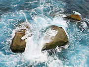 Indian Ocean (or Southern Ocean according to Australian geographers) surf crashes on ancient rock in Western Australia which was once joined with Antarctica. At Torndirrup National Park, sea water has sculpted impressive formations from coastal granite. Visit this popular park on King George Sound in Western Australia, 400 km southeast of Perth and 10 km south of Albany. The park's oldest gneiss, seen along the cliff walls of the Gap, was formed 1300-1600 million years ago. The granites were formed later as molten rock rose to the surface when the Australian Plate collided with the Antarctic Plate 1160 million years ago.