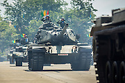 29 SEPTEMBER 2014 - NAKHON NAYOK, NAKHON NAYOK, THAILAND: A Thai army M60 battle tank in the parade at the retirement ceremony for more than 200 Thai generals including Gen. Prayuth Chan-ocha, who led the 22 May coup against the civilian government earlier this year. Prayuth has been chief of the Thai army since 2010. After his retirement, Gen. Prayuth will retain his posts as head of the junta's National Council for Peace and Order (NCPO) and Prime Minister of Thailand. Under Thai law, military officers must retire at 60 years of age. The 200 generals who retired with Prayuth were also his classmates at the Chulalomklao Royal Military Academy in Nakhon Nayok. The M60, a US designed tank from the early 1960s, is being replaced by T84 tanks bought from Ukraine.    PHOTO BY JACK KURTZ