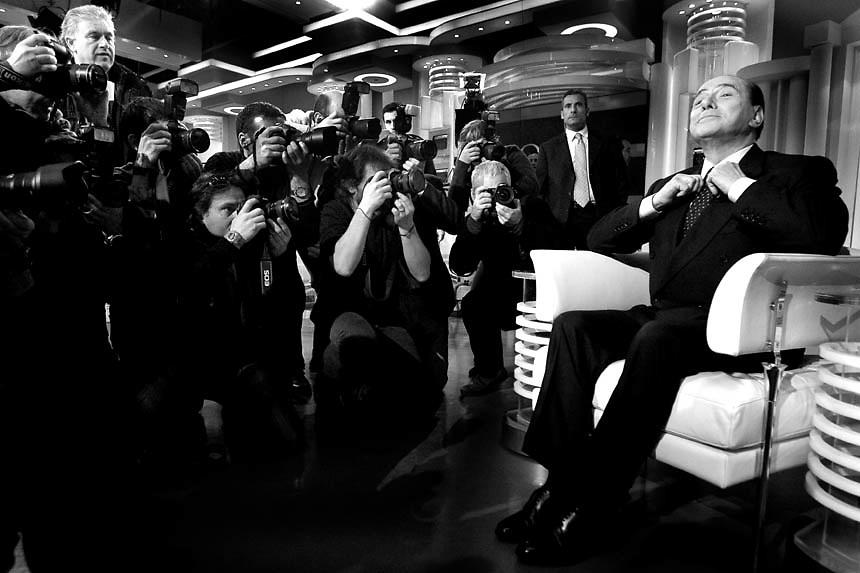 "Silvio Berlusconi, leader of the center right coalition poses for photographers prior the beginning of the politics italian debate show ""Porta a Porta"" at Rai's broadcast studios."