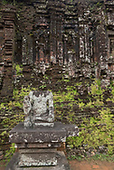 The remnants of a statue and the ruins of a Cham Temple in the Central Causeway in Group D at the My Son Sanctuary, Quang Nam Province, Vietnam, Southeast Asia