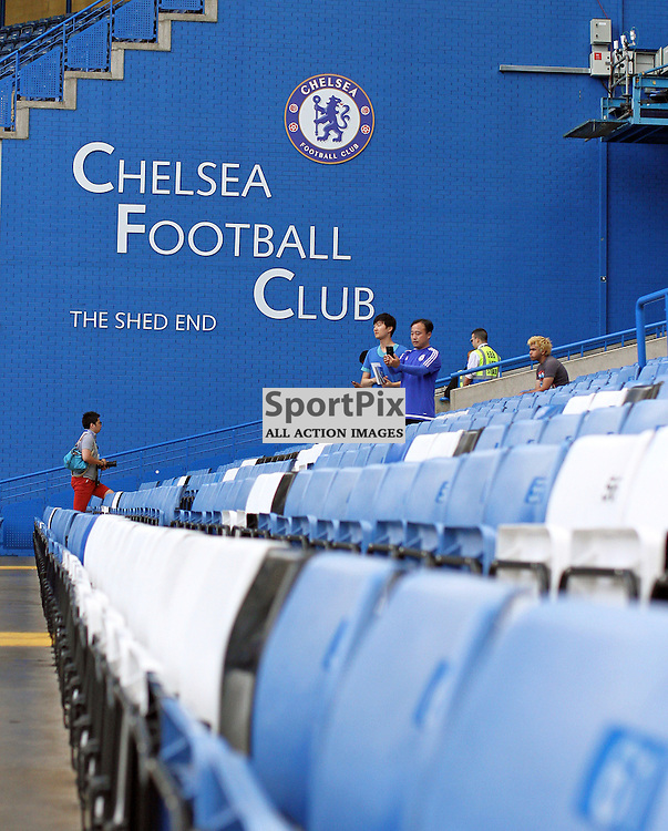 "Chelsea Football Clubs, ""Shed End"" shown on a large sign through out of focus seats before Chelsea vs Swansea on the 8th August 2015."