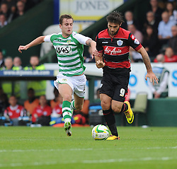 Yeovil Town's Joe Ralls battles for the ball with Queen Park Rangers' Charlie Austin - Photo mandatory by-line: Alex James/JMP - Tel: Mobile: 07966 386802 21/09/2013 - SPORT - FOOTBALL - Huish Park - Yeovil - Yeovil Town V Queens Park Rangers - Sky Bet Championship