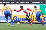 Mal Benning, Mohamed Eisa and Hayden White  during the EFL Sky Bet League 2 match between Mansfield Town and Cheltenham Town at the One Call Stadium, Mansfield, England on 20 January 2018. Photo by Antony Thompson.