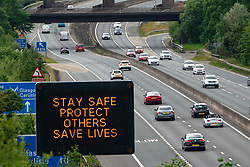 Glasgow and Haggs, Scotland, UK. 20 June, 2020. Variable message boards beside motorways in  central Scotland with new official government health advice about how to tackle the covid-19 and coronavirus pandemic. Stay Safe, Protect Others, Saves Lives is the new slogan.  Pictured; Display beside M80 near Haggs.  Iain Masterton/Alamy Live News