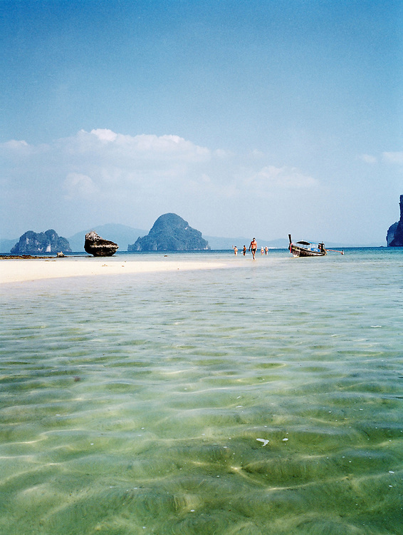 Wading beach at one of the limestone islands that dot Phangna Bay off the eastern shores of Phuket, Thailand.